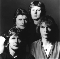 Original lineup in 1982 (clockwise from bottom left): John Wetton, Carl Palmer, Geoff Downes, Steve Howe