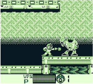 Mega Man: Dr. Wily's Revenge - Mega Man shoots an enemy in Fire Man's stage. The player's health and number of lives are shown at the bottom.