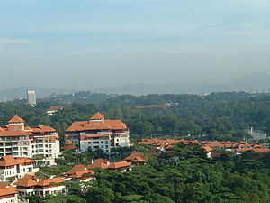2006 Southeast Asian haze - Similar shot on the morning of 2 November 2006. Notice the Parliament, the Tugu Negara and the mountains.
