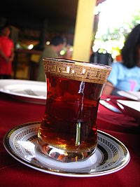 A glass of red-colored tea