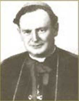 Robert John Armstrong - Bishop Robert Armstrong in black cassock with amaranth trim, pectoral cross and zuchetto