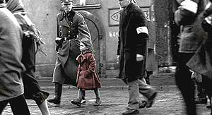 Schindler's List - Schindler sees a girl in red during the liquidation of the Kraków ghetto. The red coat is one of the few instances of color used in this predominantly black and white film.