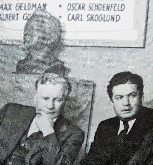 James P. Cannon - Cannon and Felix Morrow, with a bust of Trotsky.