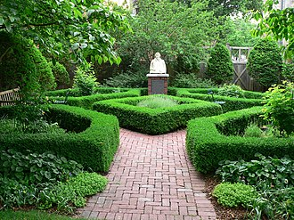 """Elizabethan Club - Architect Kenneth Boroson, 1995-6, Elizabethan Club Garden. Engraved under the bust of Shakespeare: """"I know a bank where the wild thyme blows, where oxlips and the nodding violet grows, Quite over-canopied with lush woodbine, With sweet musk-roses, and with eglantine..."""""""