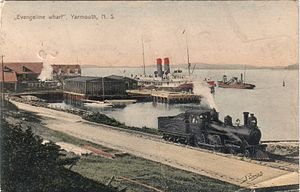 Dominion Atlantic Railway - A DAR locomotive shunts passenger cars connecting with DAR steamships at Yarmouth circa 1910.