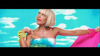 """Alive (Natalie Bassingthwaighte song) - Bassingthwaighte in one of many looks from the """"Alive"""" music video."""