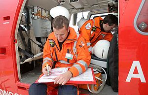 Gareth Davies (doctor) - Gareth and Paramedic Steve Johnson carrying out the pre-duty flight checks for life-saving emergency medical equipment and drugs.