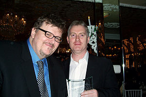 Conspiracy of Silence (film) - Deery with Michael Moore in 2005 after accepting NBR award