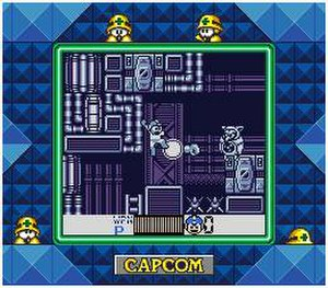 Mega Man V (Game Boy) - The player fires the Mega Arm at an enemy. A Super Game Boy border surrounds the screen.