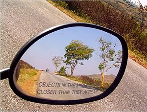 Objects in mirror are closer than they appear - Side-view mirror with legend