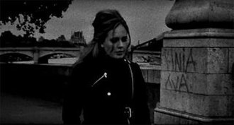 "Someone like You (Adele song) - Adele walking alone in Paris in the black-and-white music video for ""Someone like You"""