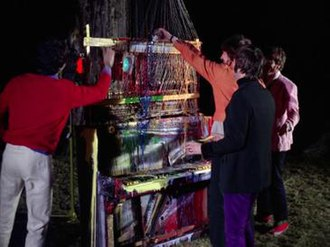 Strawberry Fields Forever - The Beatles (McCartney, Harrison, Starr and Lennon) pouring paint over the piano–harp construction