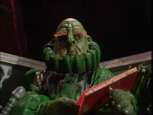 Vogon - Jeltz reading poetry at Arthur Dent and Ford Prefect in the television series.