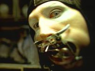 """The Beautiful People (song) - Manson in the music video's """"dental device"""" costume"""