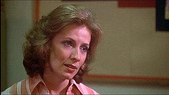 Rita Desjardin - Betty Buckley portraying Rita Desjardin (known as Miss Collins in the original film)