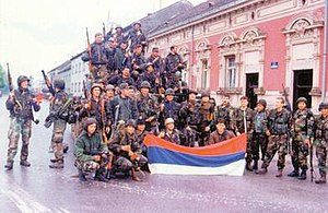 Operation Flash - The HV in Okučani, with members photographed holding a captured RSK flag on 2 May 1995.