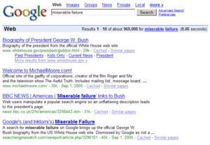 "Google bomb - An example of Google bombing in 2006 that caused the search query ""miserable failure"" to be associated with George W. Bush and Michael Moore."