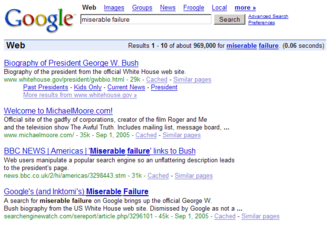 """Google bomb - An example of Google bombing in 2006 that caused the search query """"miserable failure"""" to be associated with George W. Bush and Michael Moore."""