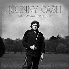 A black-and-white photograph of Cash dressed in black with a guitar slung around his back. The title and artist are written on top of the cover.