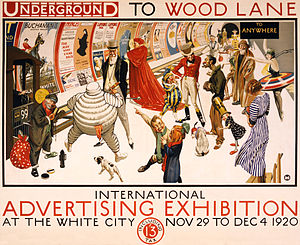 Wood Lane tube station (Metropolitan line) - Advertising poster by Frederick Charles Herrick for transportation to an exhibition at White City, showing an assemblage of characters representing various advertising trademarks and emblems, including Bibendum, the Michelin Man; Johnnie Walker; and the Kodak Girl, in a station displaying advertising posters