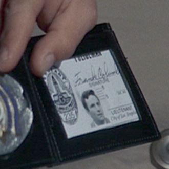 """Columbo (character) - Columbo's LAPD ID card and badge with the name Frank Columbo in the episode """"Dead Weight""""."""