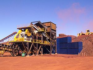 Shipping container architecture - Shipping containers stacked to form a semi-permanent wall at an iron ore mine in Western Australia