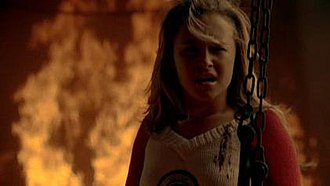 Genesis (Heroes) - Claire Bennet in a burning train.