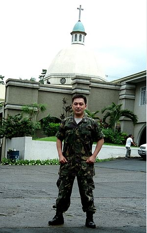 Military Ordinariate of the Philippines - A Chaplain of the Armed Forces standing in front of St Ignatius Military Cathedral.