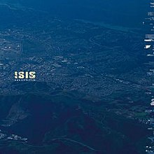The album cover shows an aerial photograph of an American city, washed with a distinct blue hue. The band name and album title are visible, relatively small, halfway up the left side of the art.