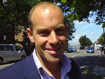 Phil Spencer posing whilst filming a property ...