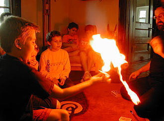 Steven Rudich - Rudich performs a magic trick at his son's birthday party.