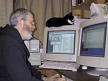 Tim Scully and his cat Merlin, writing software for Autodesk, December 24, 2000.jpg