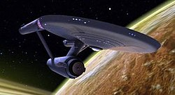 "The USS Enterprise (NCC-1701) is the main setting of the 1966-69 series, on a mission to discover civilisation, life, and ""to boldly go where no man has gone before"". Here, it is depicted in the third season episode ""Is There in Truth No Beauty?""."