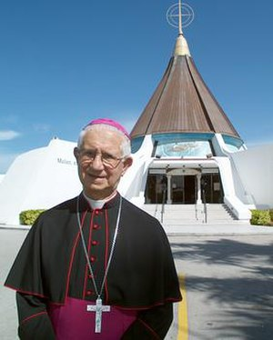Agustin Roman - Bishop Roman stands in front of the National Shrine of Our Lady of Charity in Miami.