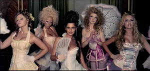 Can't Speak French - Girls Aloud in the music video with their elaborate costumes inspired by Marie Antoinette and 18th century French fashions.