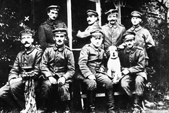 Military career of Adolf Hitler - A young Hitler (farthest left at bottom row) posing with other German soldiers and their dog Fuchsl.