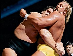 WrestleMania III - André the Giant applying a bear hug to Hulk Hogan in their WWF World Heavyweight Championship match.
