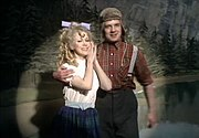 """Palin performs The Lumberjack Song, with Connie Booth as his """"best Girl."""""""