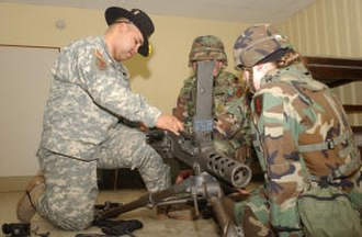Order of the Spur - A spur holder with the U.S. 4th Cavalry Regiment instructs candidates on the assembly of an M2 Browning machine gun after their first try during a 2006 spur ride.