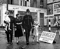 Post-WWII: Walking Past an Unexploded Bomb