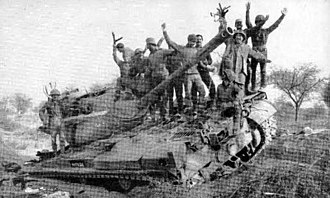 Battle of Basantar - Indian Army personnel celebrate Indian victory at the end Battle of Basantar on top of a knocked out Pakistani Patton tank.