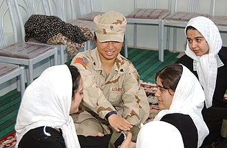 Civil affairs - Spc. Danielle Curtis with the 401st Civil Affairs Battalion, Webster, New York, demonstrates to students the proper way to apply a field dressing during a basic first aid class at the Mehry Girls School in the city of Herat, Afghanistan, April 29, 2004.