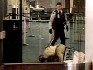 Robert Dziekański Taser incident - October 14, 2007: Screenshot from video taken by Paul Pritchard showing Robert Dziekański shortly after being tasered by RCMP officers at Vancouver airport.