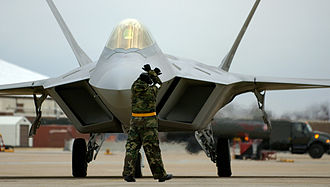 Air Combat Command - F-22A from the 1st Fighter Wing, 27th Fighter Squadron, Langley AFB, Virginia being guided into place on the flightline