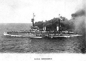 HMS Invincible (1907) - Invincible underway, note the copious amount of smoke produced.