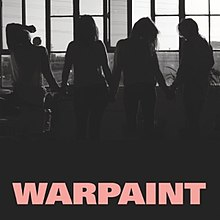 "A black-and-white photograph featuring a silhouette of four women standing in a loft windowsill. Pink uppercase text at the bottom center reads ""Warpaint""."