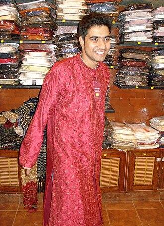 Kurta - A modern shin-length embroidered silk kurta in Bangalore, India.