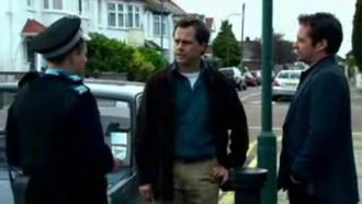 """Lead Balloon - In a scene from """"£5000"""", after crushing Michael's legs with his car, Rick (centre) incompetently tries to lie his way out of the situation when questioned by a Police Community Support Officer, while Marty (right) stands by in disbelief."""