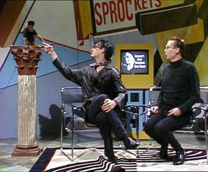 "Sprockets (Saturday Night Live) - Karl-Heinz Shalke (Kyle MacLachlan) obliges Dieter's request to ""touch my monkey""."