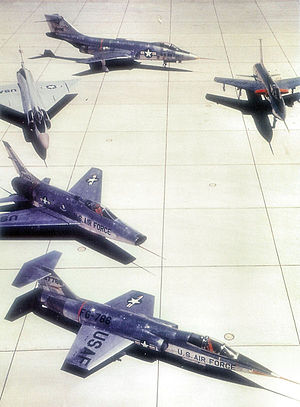 "Photograph of the ""Century Series"" of Tactical Fighters.  Starting at the bottom moving clockwise, Lockheed F-104 Starfighter, North American F-100 Super Sabre, Convair F-102 Delta Dagger, McDonnell F-101 Voodoo, and Republic F-105 Thunderchief.  All served in TAC except the F-102, which did serve with ADC, USAFE, PACAF and ADC-gained ANG units."